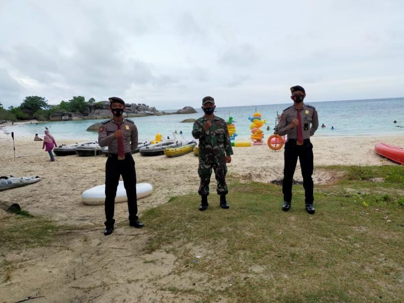 Libur Panjang Danramil 414-01/Tanjungpandan Memantau Tempat Wisata Pantai Tanjung Tinggi.